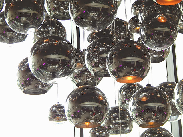 Silver spheres with lights hanging at different lengths in the G hotel Galway