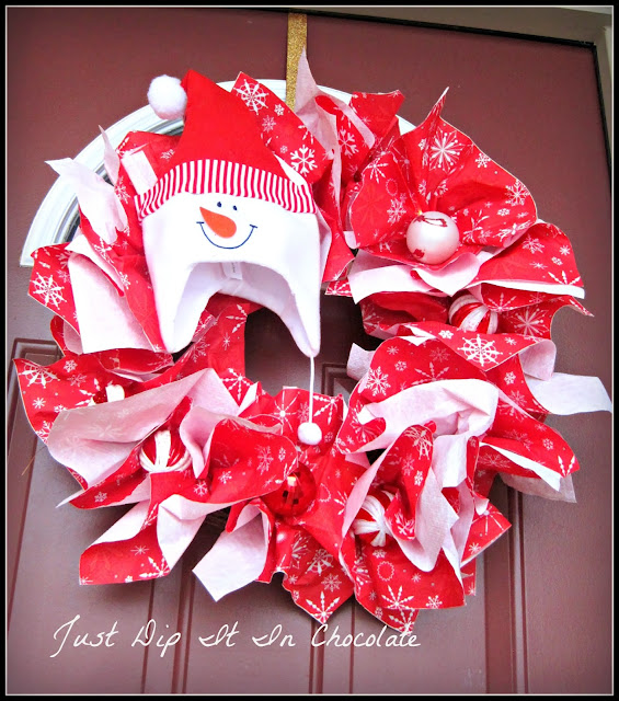 DIY Snowman Christmas Paper Napkin Wreath, not just for Christmas but for the entire Winter, this wreath would bring a smile to your guest when they are greeted by it's bright colors and festive cheer! #snowman #cheer #holiday #winter #wreath