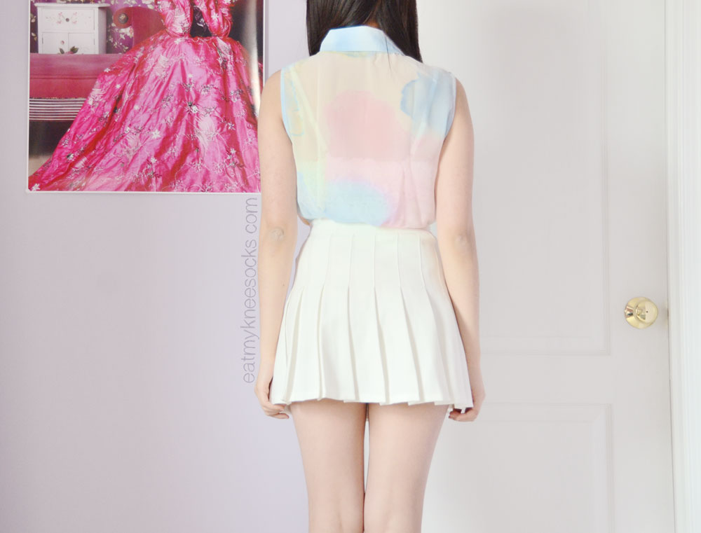 The back of the sleeveless pastel abstract watercolor-print blouse from Romwe.