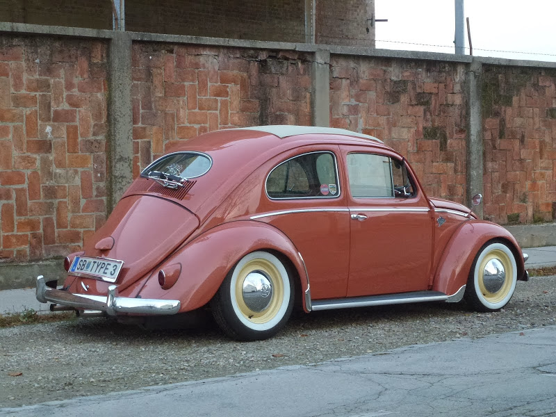my ex coral red1955 US rag top bug