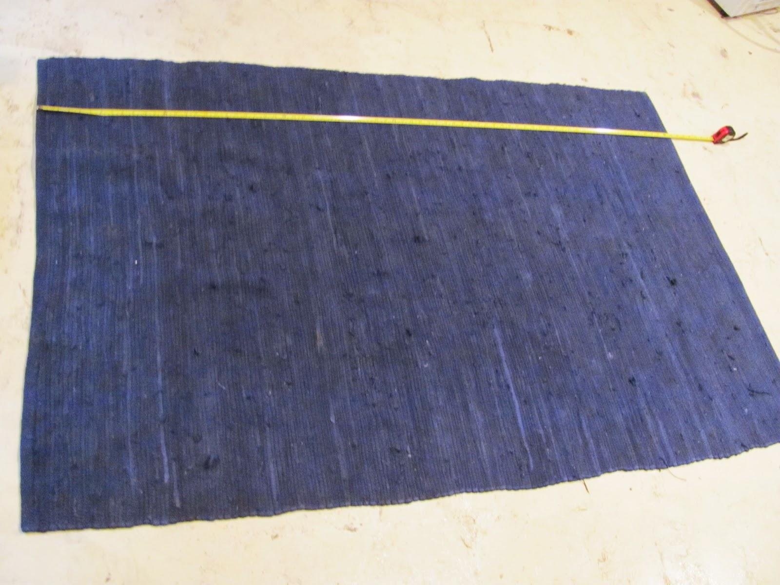 Dark blue area rug on display before being sold on Craigslist