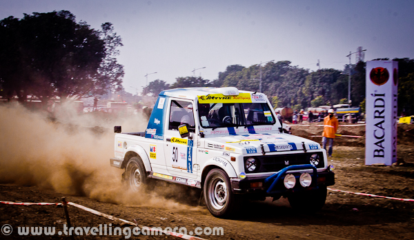 This photograph was clicked during one of the motorsport event which happened during last week. It was a three days event and various competitions happened during these three days. Whole area around this ground was full of dust duirng these three days. For more photographs from this event, check out - http://phototravelings.blogspot.com/2011/12/dust-storm-at-mohali-chandigarh-punjab.html