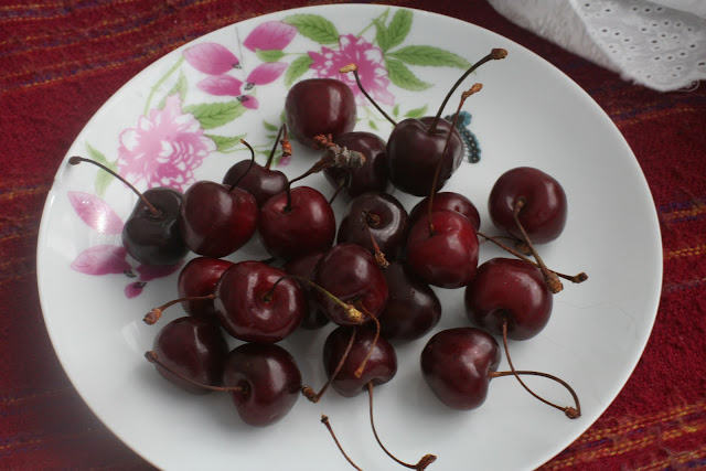 Cherries on a plate.