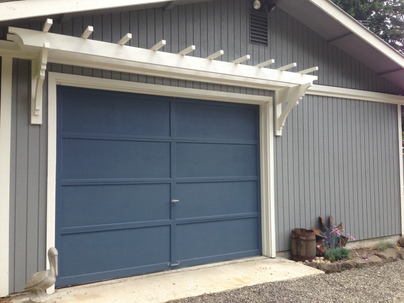 Blue roof cabin diy trellis over the garage door update garage door is painted solutioingenieria Choice Image