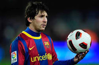 lionel messi with football in hand