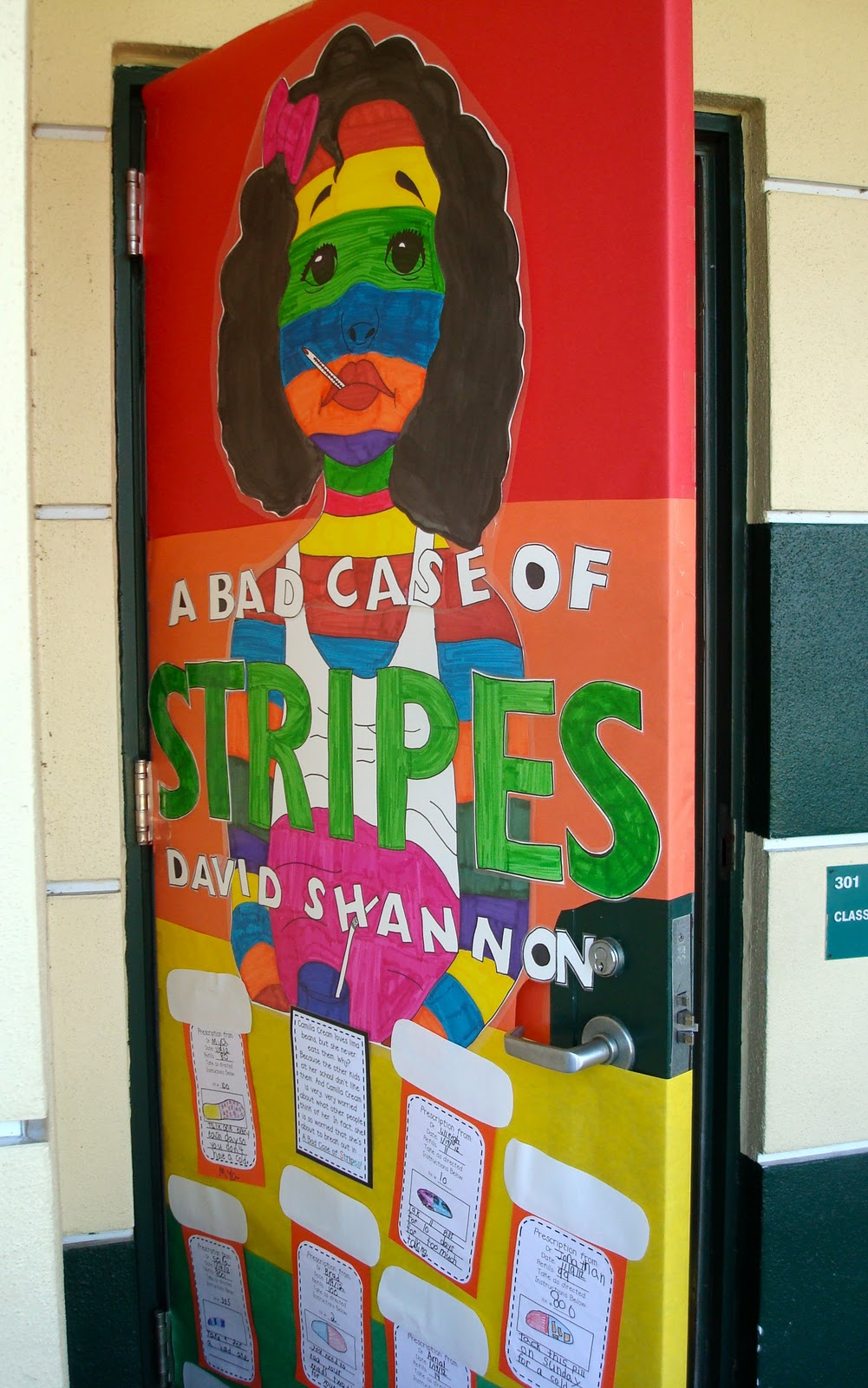A year of many firsts a bad case of stripes the book nook for Back to school classroom door decoration ideas