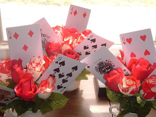 For Alice In Wonderland themed events utilize playing cards