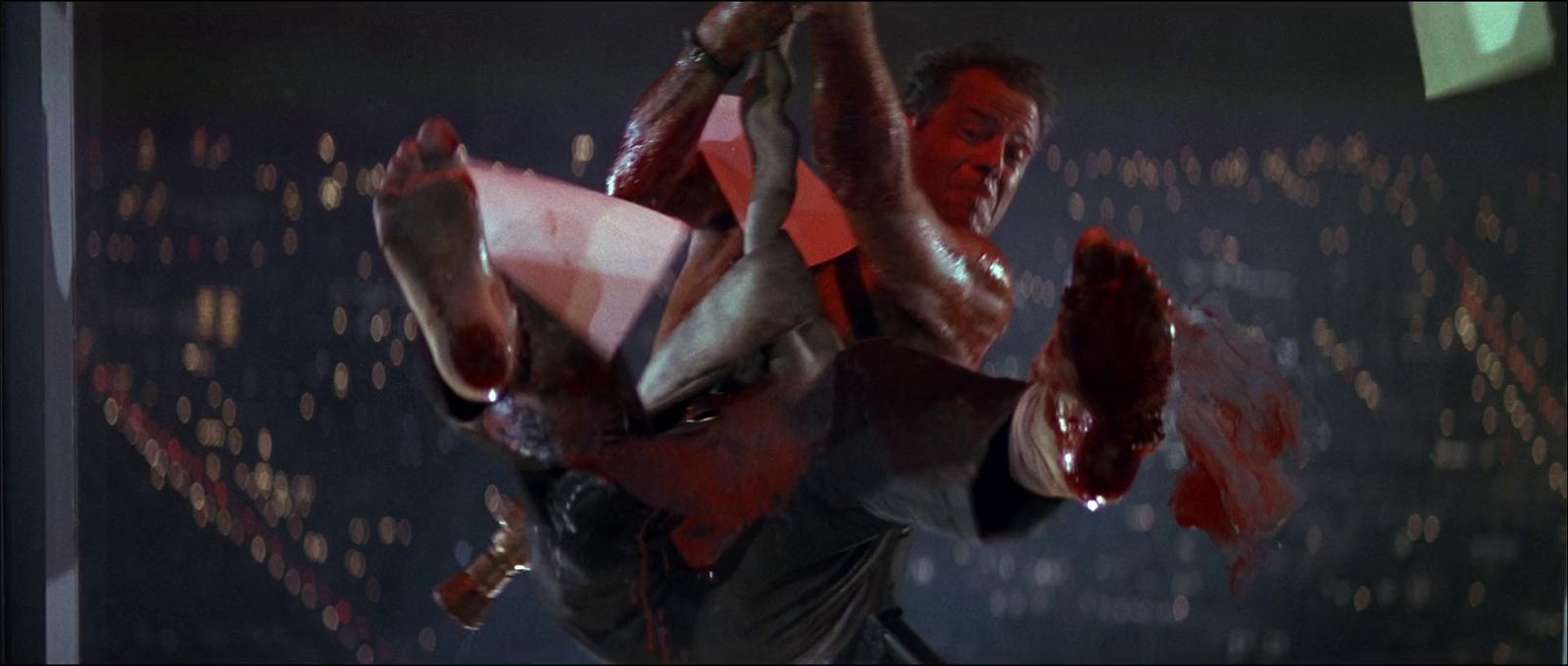 Die Hard 1988 Bruce Willis John McClane film rooftop fire hose jump screenshot window