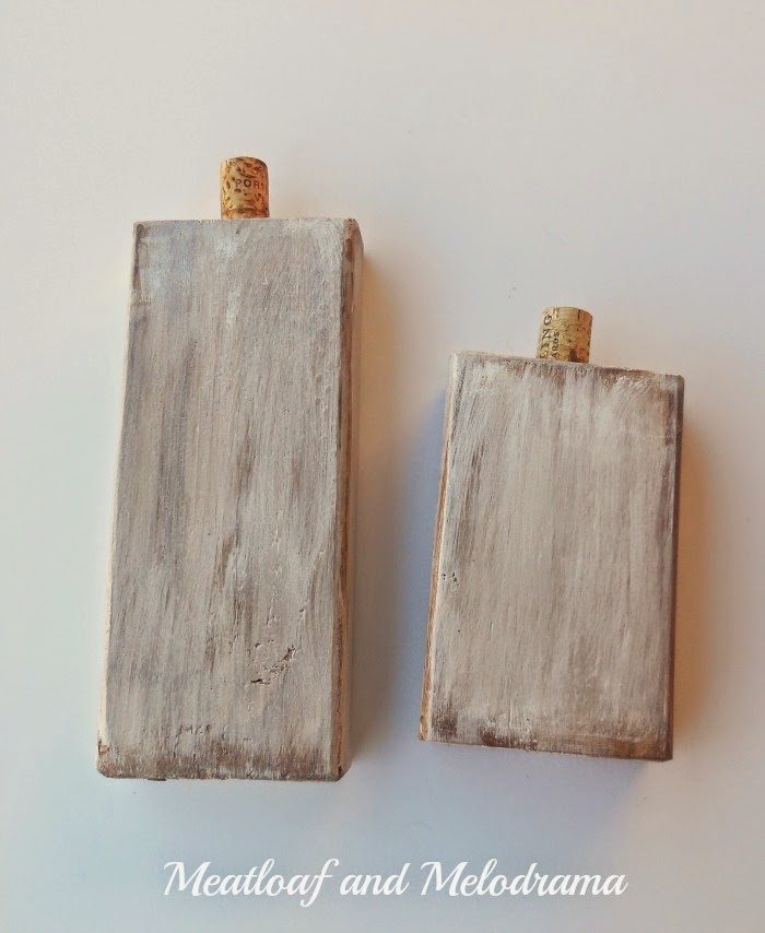 wood blocks distressed and painted white with wine cork for stem
