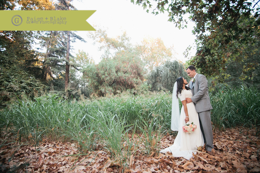 Wedding Romantics in a field - long veil - fall wedding : Photo by Paige and Blake Green