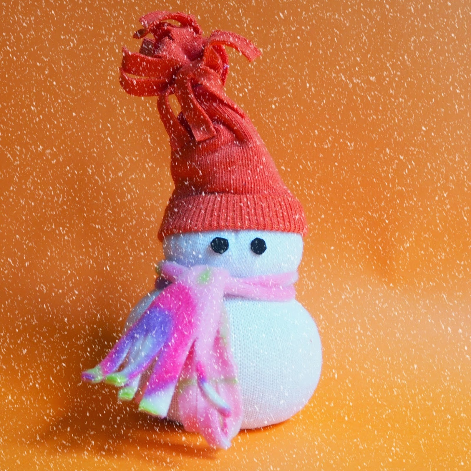 http://www.colouredbuttons.com/2014/11/no-sew-sock-snowman-from-downunder.html
