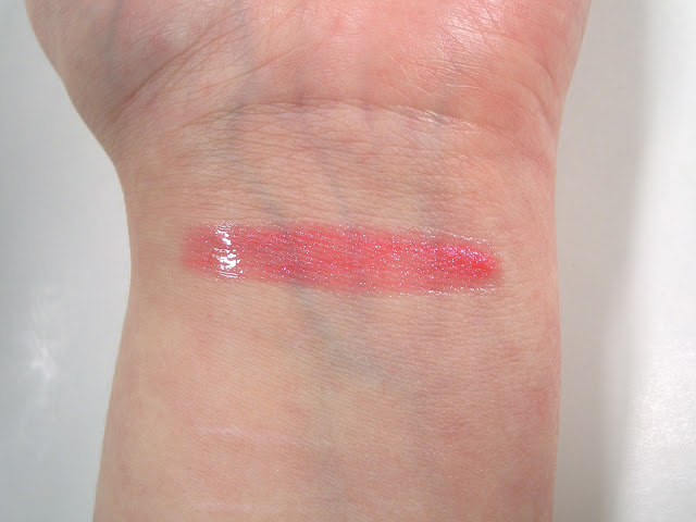 Chanel Friandise 82 Aqualumière Gloss Swatch in indoor lighting
