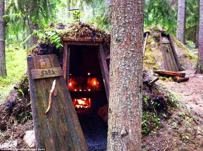 Guests at Kolarbyn stay in a hut that seems to rise right out of the ground in the forest. - This Lodge In Sweden Helps You Relax By Giving You Really Hard Work.