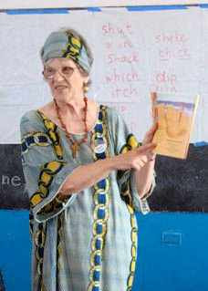 Photograph of Carol Pringle teaching literacy in Liberia, Africa 2010