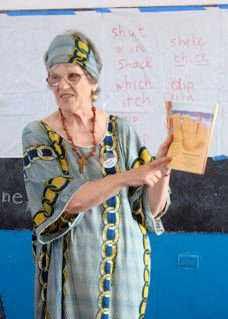 Photograph of Carol Pringle teaching literacy in Liberia, Africa 2010