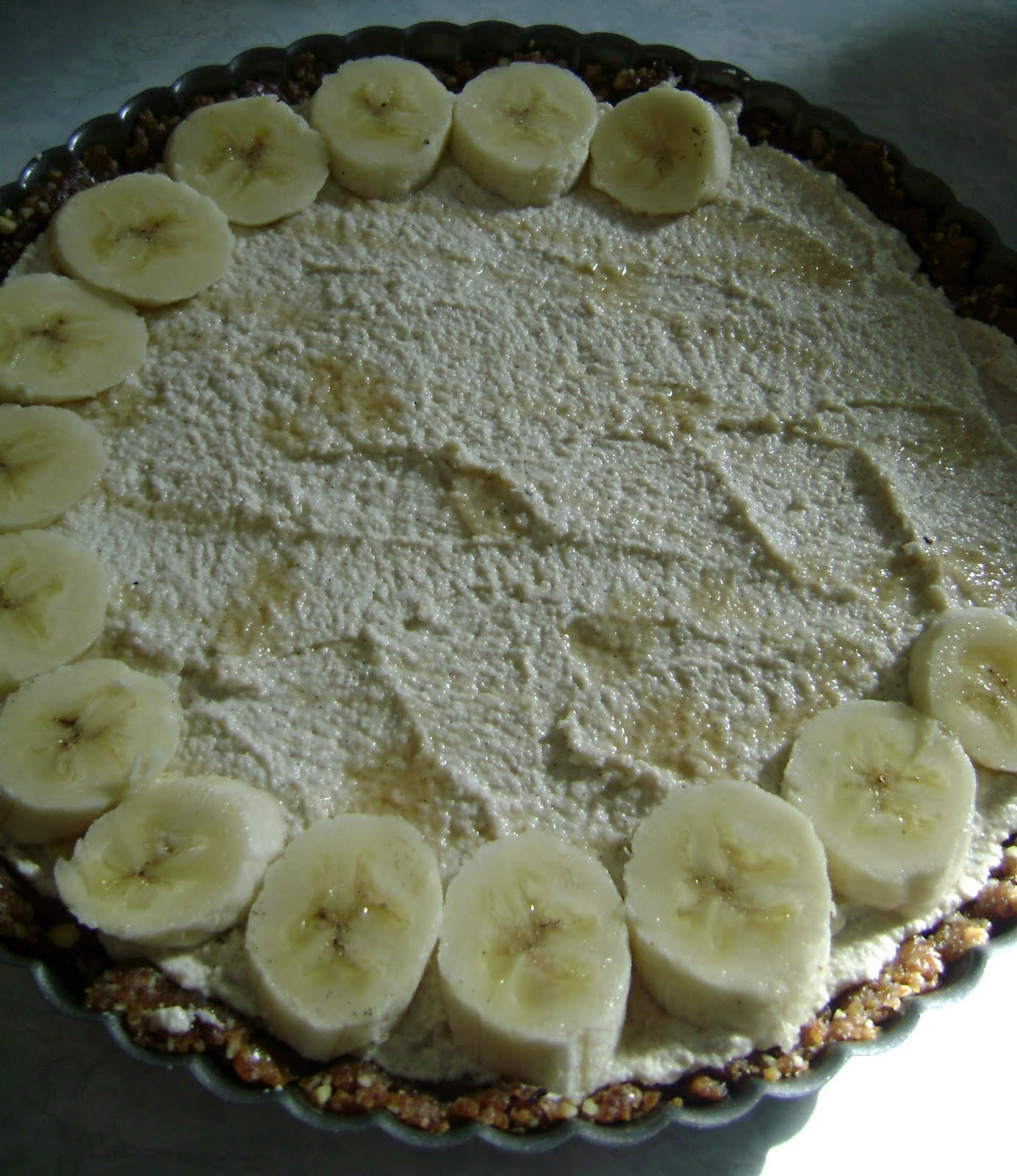 Layering the bananas over the cashew cream, which I had drizzled with ...
