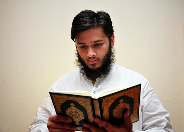 Reading Quran © Flickr