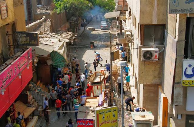 صور تُنشر لأول مرة لأحداث ميدان الجيزة ونفق الهرم أثناء مذبحة الفض 1476476_10202609928749859_1084614865_n