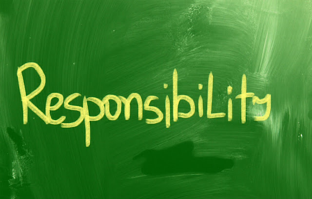 Responsibility text in yellow letters on green paint background