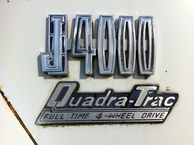 1972 Jeep J4000 badge.