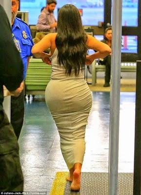 Photos: Even Kim Kardashian takes her shoes off to go through airport security