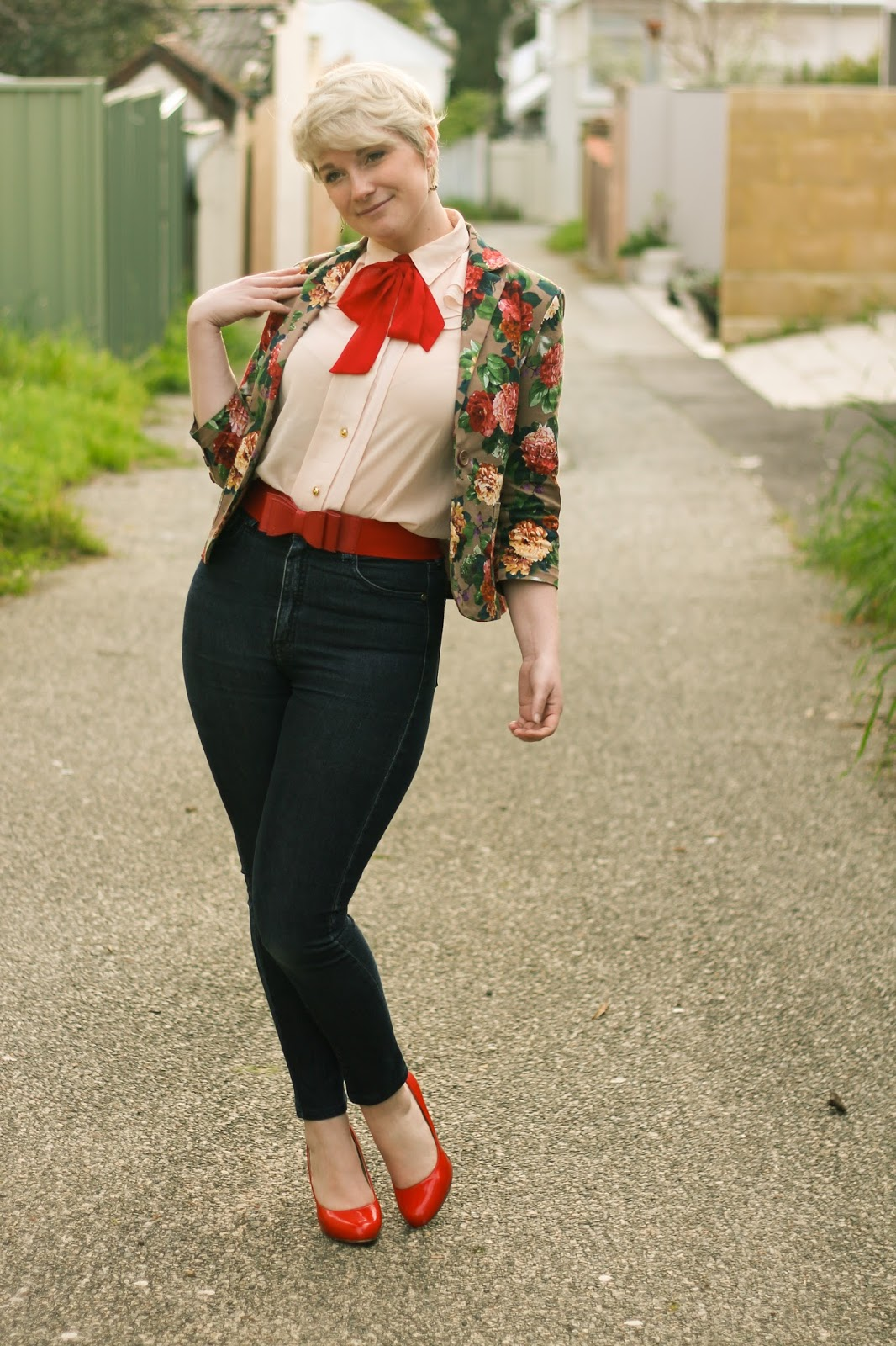 Liana of Finding Femme wears Modcloth blouse with red necktie, red patent pumps, custom skinny jeans, floral Dangerfield blazer.