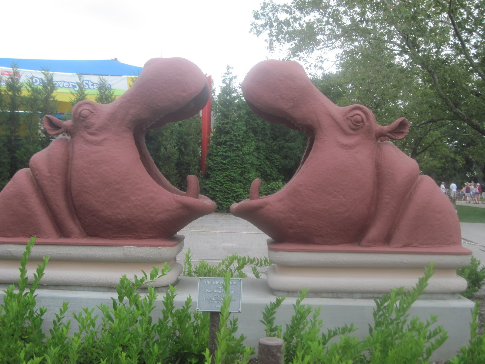 the schramm journey  this sculpture can be found at the toledo zoo it is called the hippo arch i do believe that it is a bit more exciting than the arch of st louis missouri