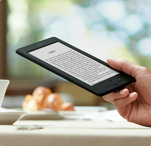 photo of hand holding a Kindle