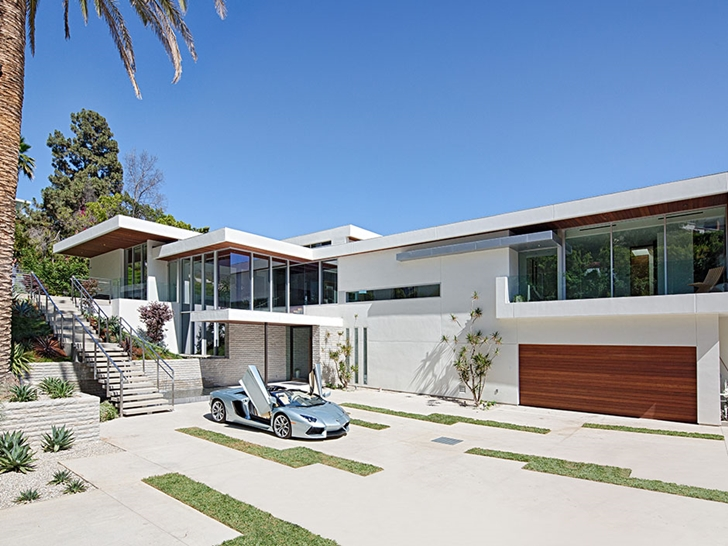 Sunset Plaza Drive modern mansion in Los Angeles with sports car