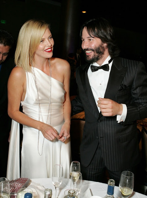 Keanu Reeves and Charlize Theron Photos