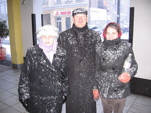 family covered in snow