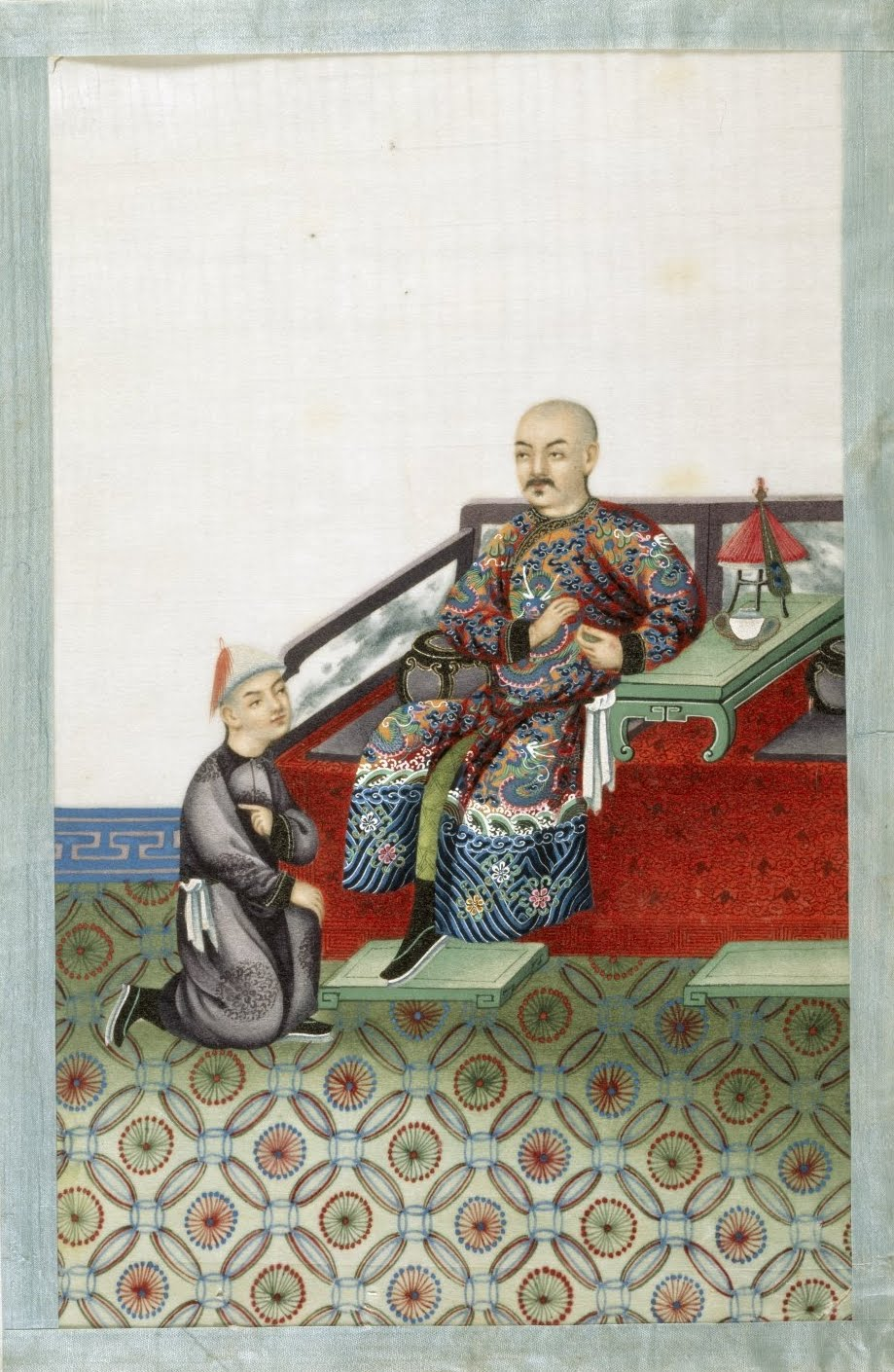 servant kneels before nobleman in China