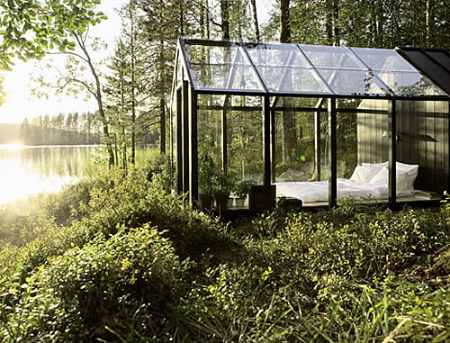 A Glass Bedroom In The Forest.