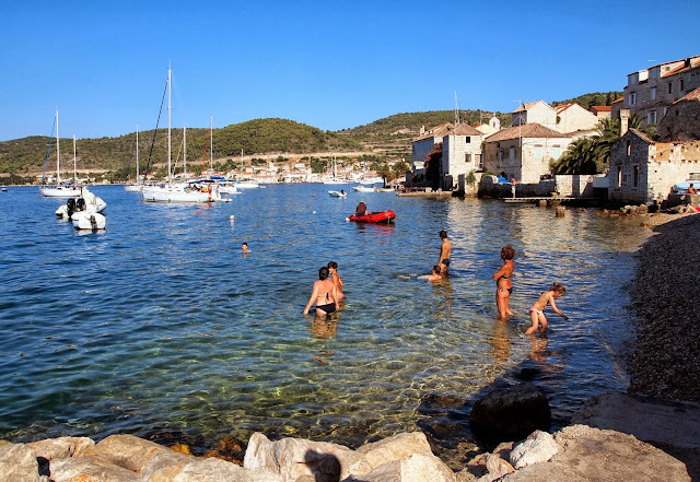 Locals swimming on the island of Vis, Croatia