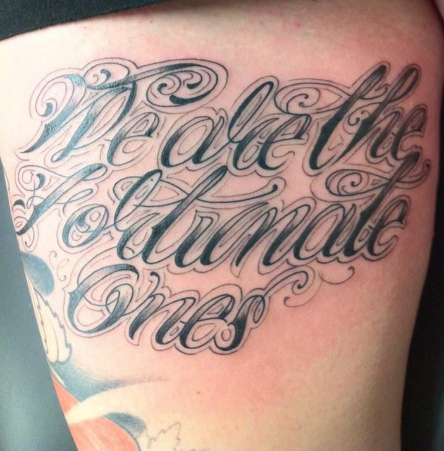 Thigh Script Tattoos