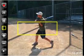 Boy videoing his swing forbaseball