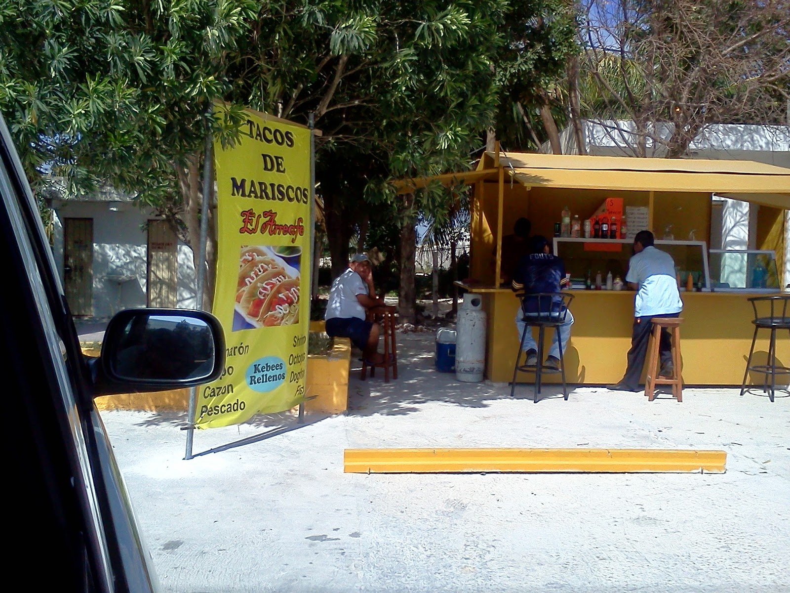 View of Taco Stand from Taxi