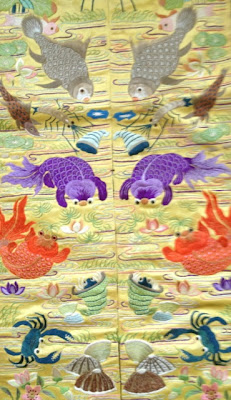 fabric with detailed embroidery of fish, crabs, etc.