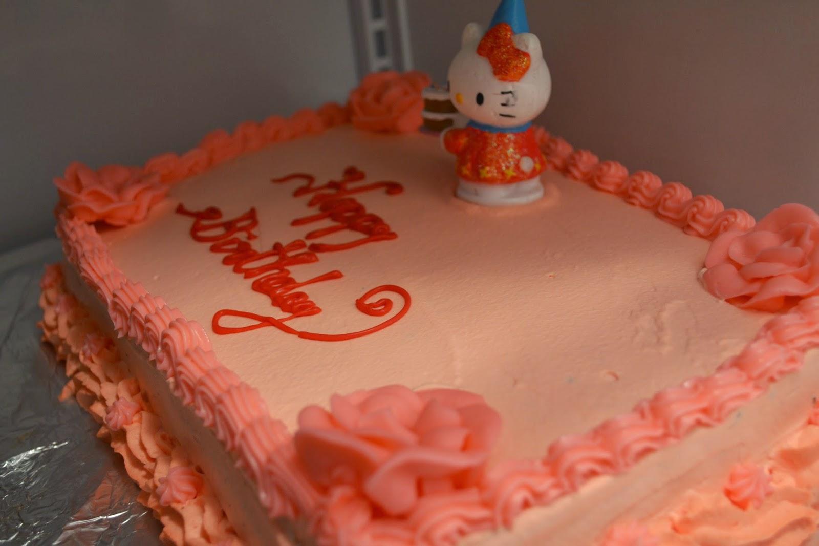 My Treasures Hello Kitty chocolate vanilla cake with whipped cream