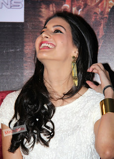 Amyra Dastur in Lovely Cute Smile Long Earings Whtie Top