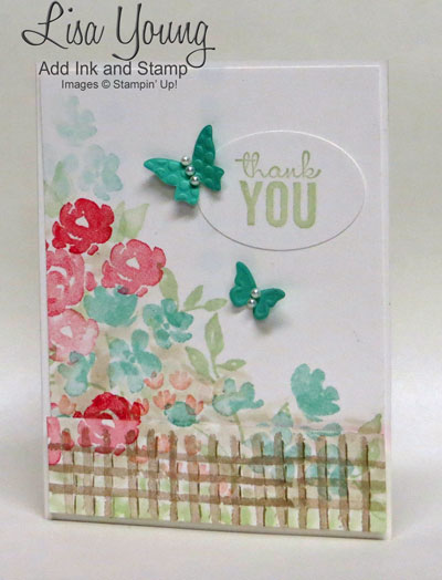 Stampin' Up! Painted Petals stamp set. White base with garden of flowers in spring colors behind a stamped fence. Hand stamped thank you card by Lisa Young