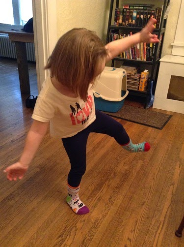 Girl wearing two differently-colored socks