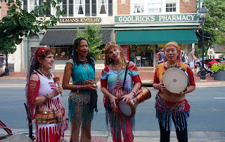 group of dancers singing and playing percussion