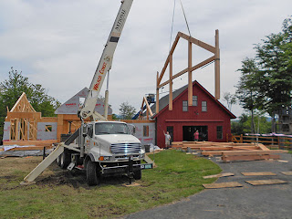 Crane raising timber frame bent into place