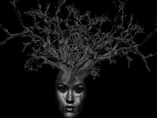 cabeça com árvore seca
