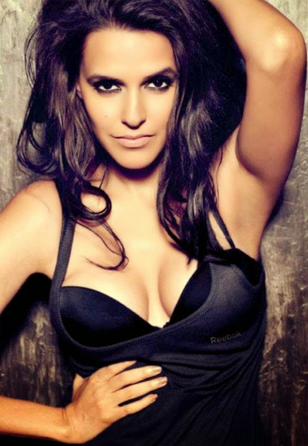 Neha Dhupia cleavage on Maxim Magazine Cover 2012