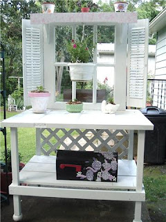 White DIY Potting Bench with shutters and scrap wood