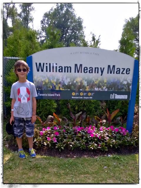 boy outside maze