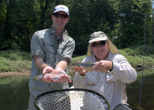 Two happy anglers with a Caney Fork brown trout and a rainbow trout