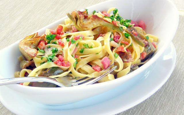 The luxurious and silky Carbonara sauce, dotted with smoky pancetta ...
